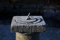 Old sundial on a cold morning Stock Photography