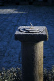 Old sundial on a cold morning Stock Photo