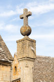 Old sundial in Stanton Cotswolds. Old sun dial topped with orb and cross in Cotswolds town of Stanton Royalty Free Stock Photos