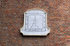 Old sundial on wall in Wassenaar, Holland Stock Photos