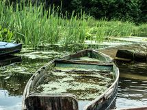 Old sunked boat sunked in the river Stock Photo