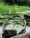 Old sunked boat sunked in the river Royalty Free Stock Image