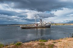 Old sunken boat in the harbor in Ushuaia, Patagonia, Argentina. Autumn Stock Photography