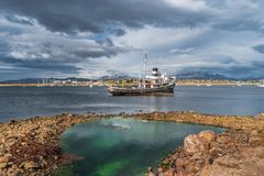 Old sunken boat in the harbor in Ushuaia, Patagonia, Argentina. Autumn Stock Image