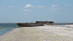 Old barge on the Black Sea. Old sunken rusty barge on the Black Sea stock video footage
