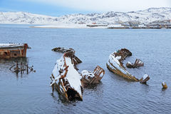 Old sunken ships. Old wrecks near the village of Teriberka, Murmansk oblast, Kola Peninsula, Russia Stock Image