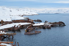 Old sunken ships. Old wrecks near the village of Teriberka, Murmansk oblast, Kola Peninsula, Russia Stock Photography