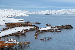 Old sunken ships. Old wrecks near the village of Teriberka, Murmansk oblast, Kola Peninsula, Russia Stock Photo