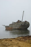 Old Sunken Whale-boat In Fog Royalty Free Stock Photos