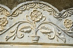 Old sunlit flowery wall ornament Royalty Free Stock Photography