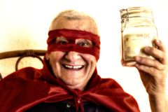 Old super hero holding money jar royalty free stock photography