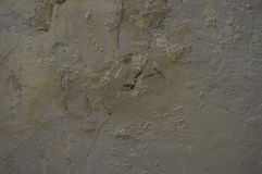 Old surface with cracks and the plaster rests. Old surface with cracks and plaster rests Stock Photography