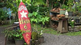 Old surfboard at a roadside stand on the road to hana. An old surfboard at a roadside stand on the road to hana, maui stock footage