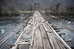 Old suspended wooden bridge Royalty Free Stock Photography