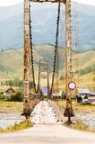 Old suspension bridge above Katun Royalty Free Stock Images