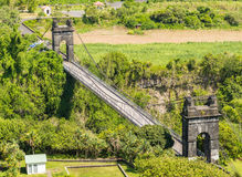Old suspension bridge in la Reunion. Old suspension bridge near Sainte-Rose in la Reunion Island Royalty Free Stock Photo
