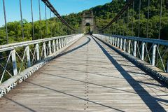 Old suspension Bridge Pont Des Anglais in St. Anne, Reunion Island. royalty free stock image