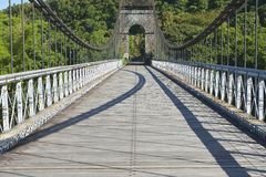 Old suspension Bridge in Pont Des Anglais, St. Anne, Reunion Island, France. Stock Photo