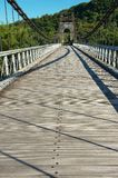 Old suspension Bridge Pont Des Anglais in St. Anne, Reunion Island. stock images