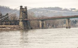 Old suspension bridge in Wheeling. An old suspension bridge in Wheeling West Virginia over the Ohio river Stock Image