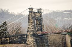 Old suspension bridge in Wheeling. An old suspension bridge in Wheeling West Virginia over the Ohio river Royalty Free Stock Photography