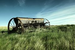 An old swather bereft on the plains. royalty free stock photo
