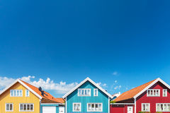 Old swedish houses in front of a blue sky. Colorful old swedish houses in front of a blue sky Stock Photos