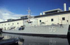 Old Swedish minesweeper HMS Bremon. In Naval Museum in Karlskrona, Sweden. Film photography, slide scan. Steerboard view, main museum building in the background royalty free stock photo