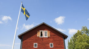 Old Swedish wooden house with flagpole Royalty Free Stock Images