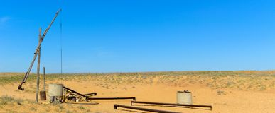 Old sweep well and shadoof in steppe stock images