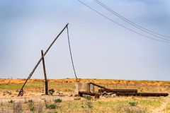 Old sweep well and shadoof in steppe stock photography