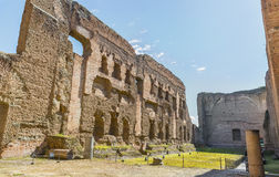 Old swimming pool( or Natatio ) in the ruins of ancient Roman Baths of Caracalla ( Thermae Antoninianae ) Royalty Free Stock Photography