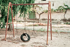 Old swing. An old and lonely swing Royalty Free Stock Images