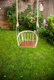 An old swing in a beautiful garden stock photography