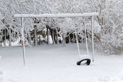Old swing covered with snow Royalty Free Stock Photo