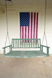 Old swing on porch Stock Images