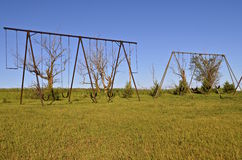 Old swing sets with chains Royalty Free Stock Photos