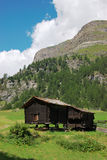 Old swiss hut in mountains Stock Photo