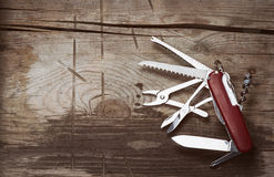 Old Swiss knife on a wooden background Stock Photography