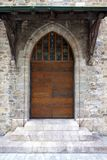Old Swiss Wooden Church Door with Stained Glass stock image