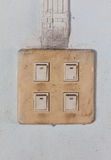 Old switch on cement wall Stock Images