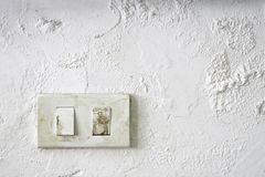 Old switch on the damp wall Royalty Free Stock Photos