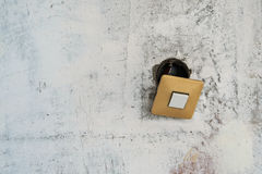 Old switch on grunge painted wall Stock Photo