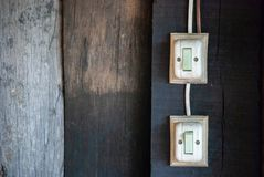 Old switch on the wall stock photography