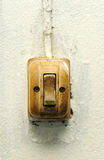 Old switch on white wall Royalty Free Stock Photography