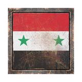 Old Syria flag. 3d rendering of a Syria flag over a rusty metallic plate wit a rusty frame. Isolated on white background Royalty Free Stock Photos