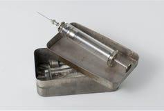Old syringe with opened sterilizing box Stock Photo