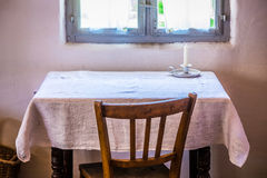 Old table and chair Stock Photos