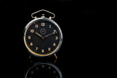 Old table clock with reflection Royalty Free Stock Photos