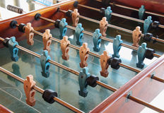 Old table football game. Old wooden table football game with plastic players Stock Photo